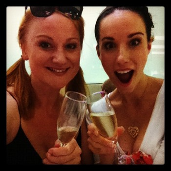 A celebratory 'clink' in honour of a wonderful series. Marika Aubrey and Erin James feature in the final How We Do What We Do.