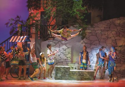 Sam Hooper as Pepper in Mamma Mia! Image by James Morgan
