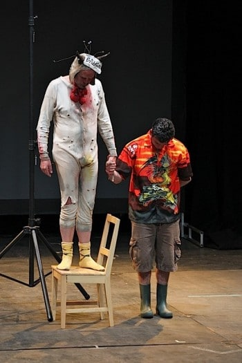 Tim Crouch and an unsuspecting audience member on stage in I, Malvolio