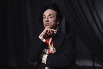 Paul Capsis as Quentin Crisp in a promotional image for Resident Alien